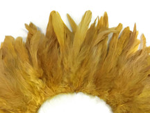 Small strip of gold yellow fluffy rooster feathers