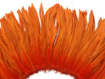 2.5  Inch Strip - Orange Strung Natural Bleach And Dyed Coque Tails Feathers
