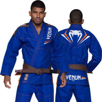 Venum Elite Jiu Jitsu Gi in Royal Blue and Orange.  Now available at www.thejiujitsushop.com Front of gi in Blue  and Orange  Enjoy free shipping from The Jiu Jitsu Shop.  Top quality brazilian jiu-jitsu gear for men women and kids.