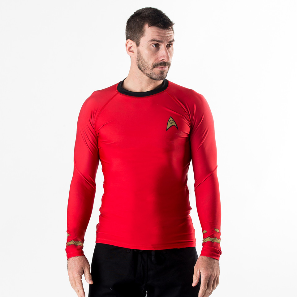 Fusion FG Star Trek Red Classic Uniform Rashguard.  Available at www.thejiujitsushop.com make sure you do not fall like the rest of the red shirts.  Enjoy all of the famous Star Trek Rashguards from The Jiu Jitsu Shop with FREE Shipping today!