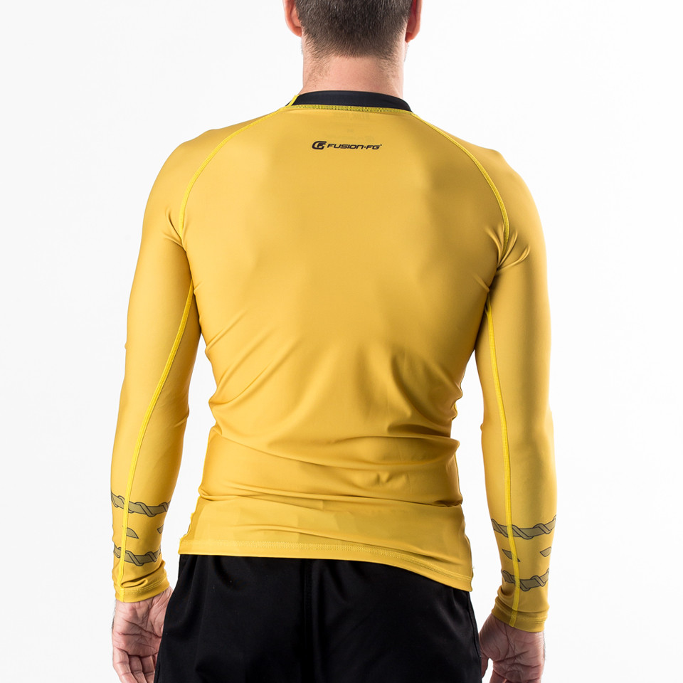 Fusion FG Star Trek Classic Uniform Rashguard - Gold an awesome homage to Captain James T Kirk himself.  Awesome rashguards from www.thejiujitsushop.com   Enjoy Free Shipping from The Jiu Jitsu Shop. Shop Star trek including blue and red uniforms