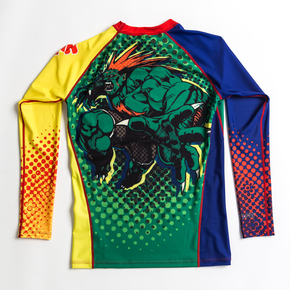 Fusion FG Street Fighter Blanka Rashguard available at www.thejiujitsushop.com Brazilian colors to pay homage to the home of BJJ and Blanka.  The back of this rashguard as pictured has a big picture of Blanka ready for action.  Enjoy Free Shipping from The Jiu Jitsu Shop today!