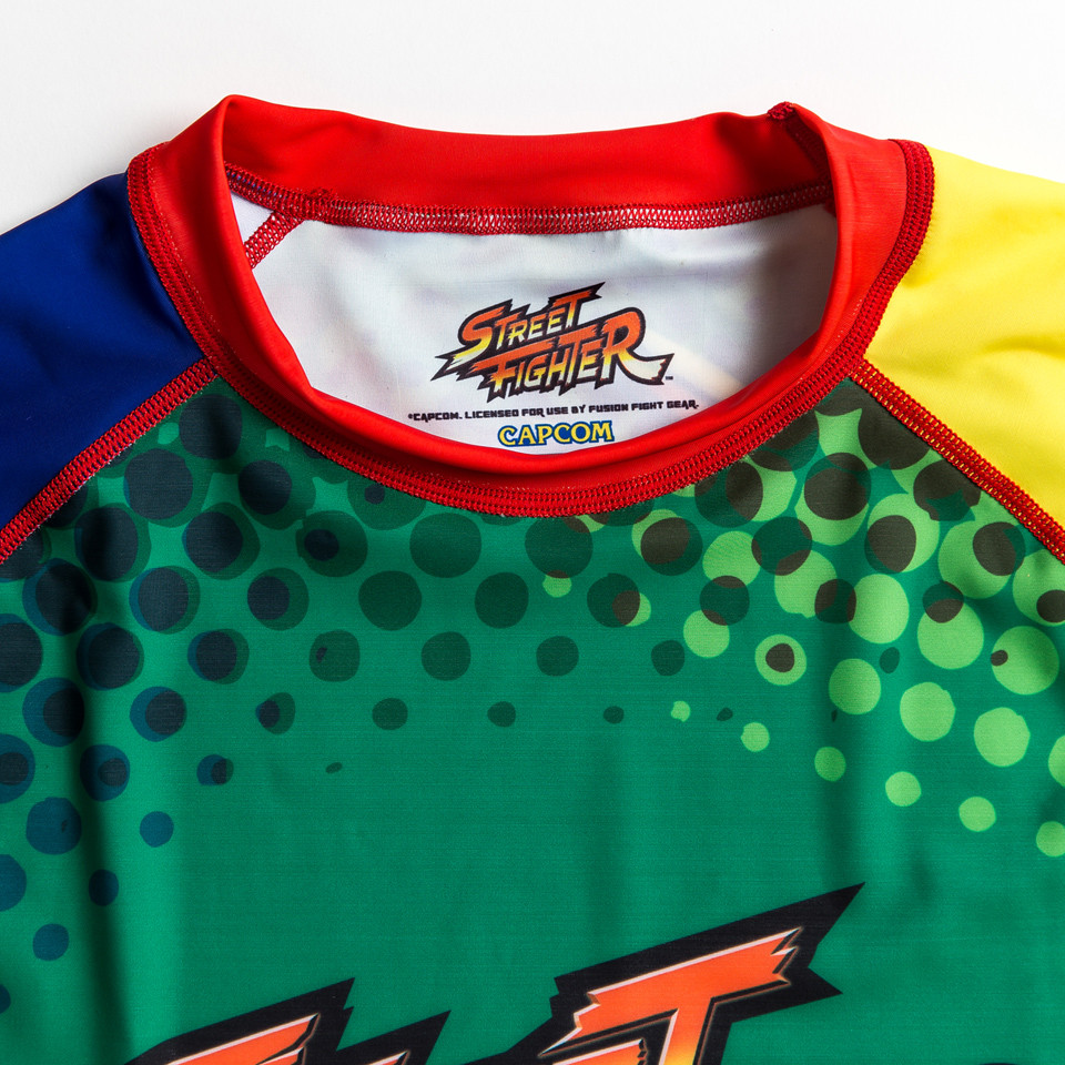 Zoom in to the tag of Street Fighter Blanka Rashguard available at www.thejiujitsushop.com