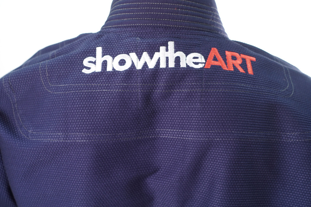 Inverted Gear X Show The Art Collaboration Gi. Navy, red, and white Kimono.  Now available at www.thejiujitsushop.com Show the art back of gi  Enjoy Free Shipping from The Jiu Jitsu Shop today.  One stop BJJ Pro Shop.