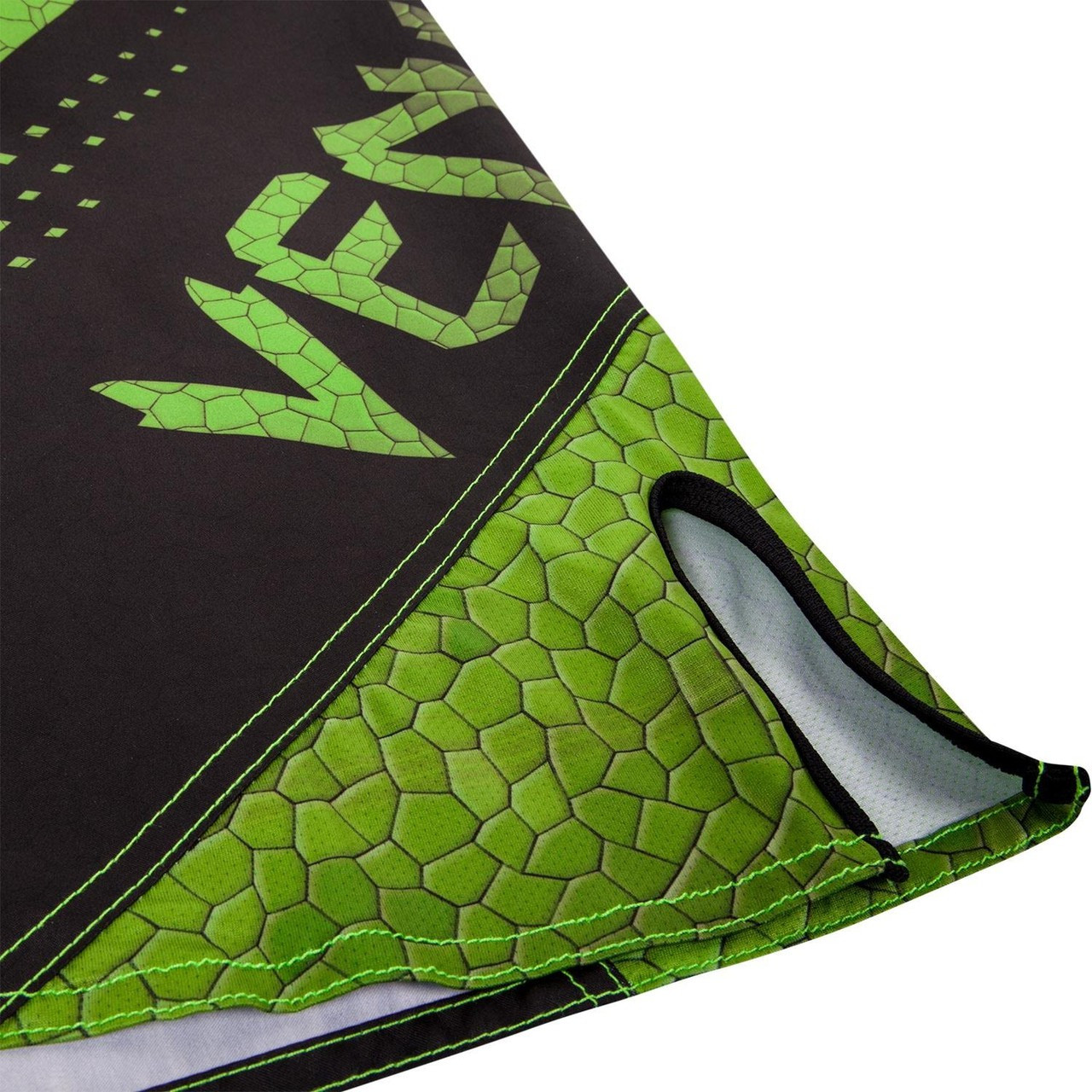 slit of the short legs of the new Venum Hurricane Fightshorts Amazonia Green MMA Shorts now available at www.thejiujitsushop.com  Top MMA and Grappling Shorts  Enjoy Free Shipping from The Jiu Jitsu Shop today!