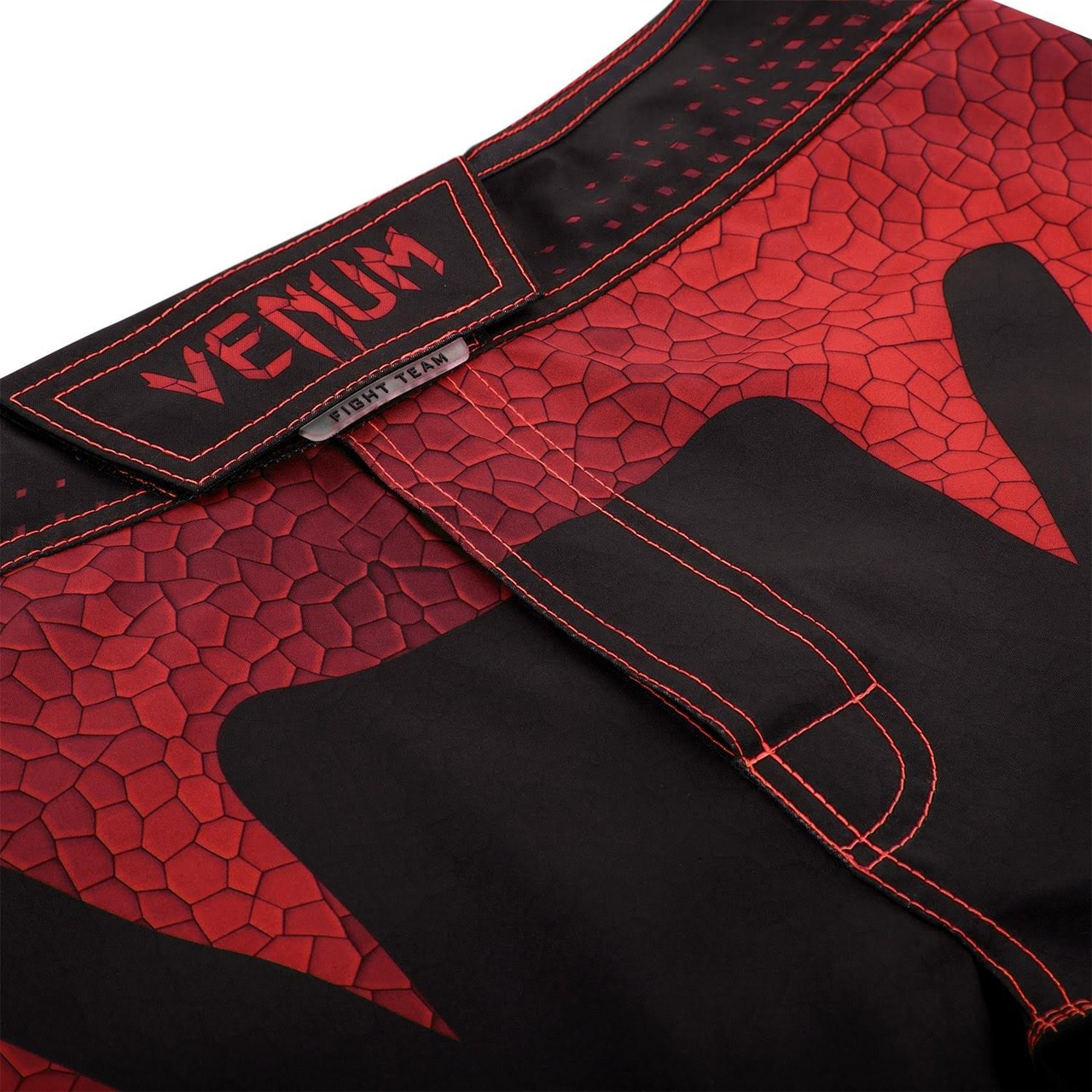 Closure zoom in to thew new Venum Hurricane Amazonia MMA Shorts in red.  Available at www.thejiujitsushop.com  Enjoy Free Shipping from The Jiu Jitsu Shop today!