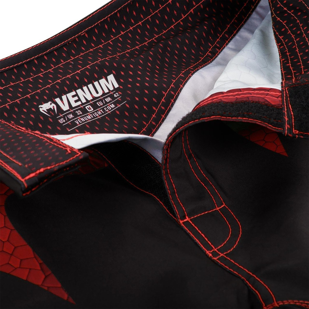 closure zoom of the new Venum Hurricane Fightshorts Amazonia Red MMA Shorts now available at www.thejiujitsushop.com  Top MMA and Grappling Shorts  Enjoy Free Shipping from The Jiu Jitsu Shop today!