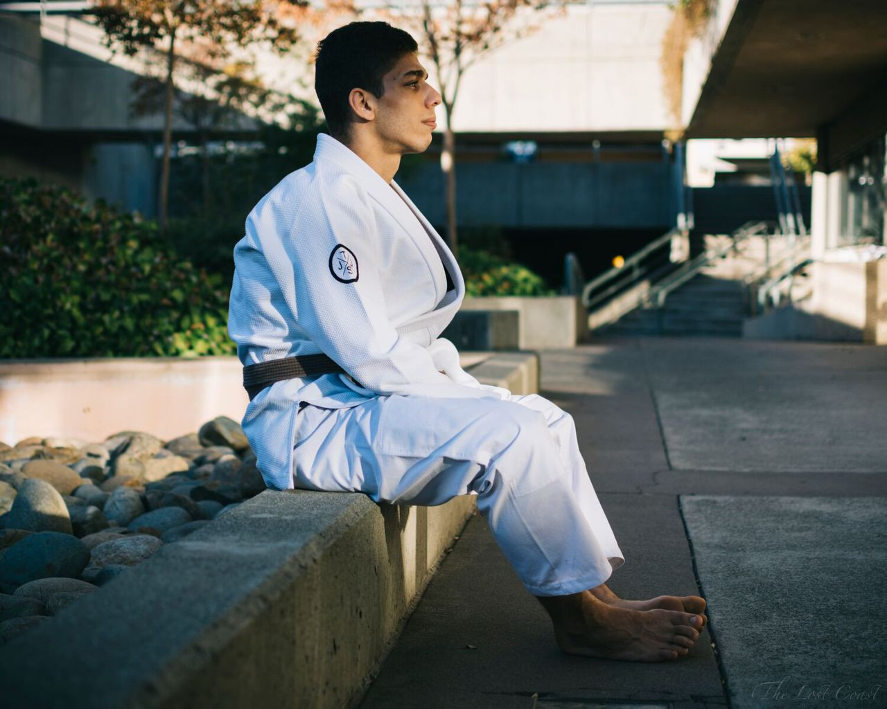 The Minimalist gi side view of Pedro Silva sitting down.  Available at www.thejiujitsushop.com  enjoy Free Shipping today!