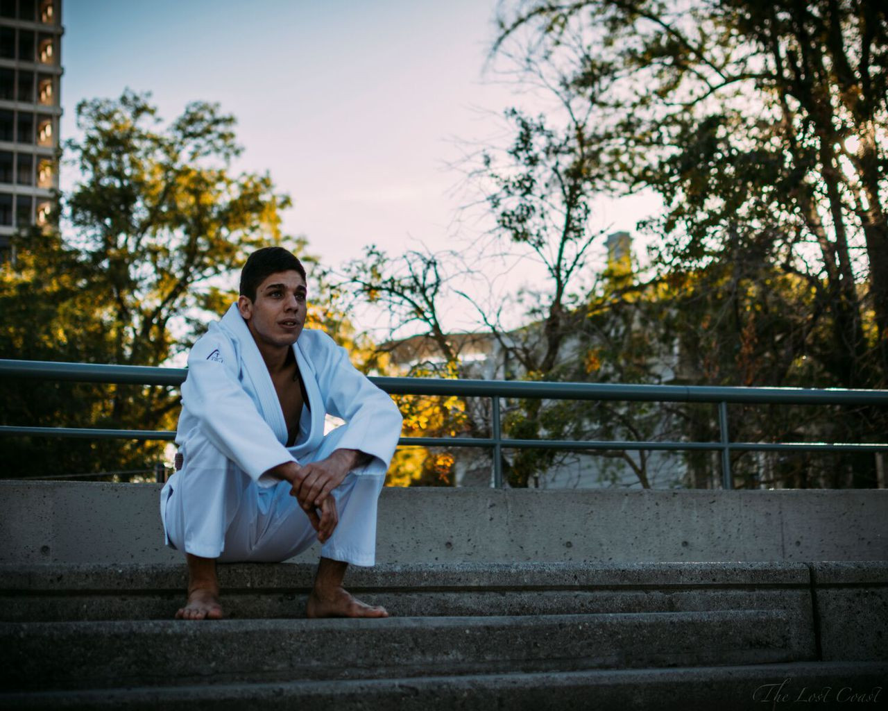 Sitting down thinking about how to choke the whole world out.  Pedro Silva in The Jiu Jitsu Shop Minimalist Kimono