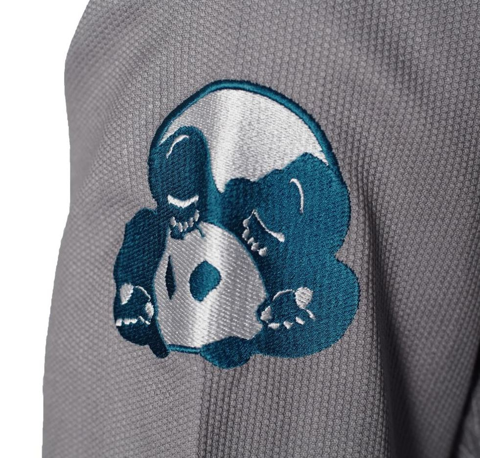 Shoulder embroidery of the Inverted Gear Light Pearl Grey Jiu Jitsu Gi.  Available at www.thejiujitsushop.com While supplies last.  Sold out quickly last time!   Do not wait.  Grab a new Inverted gear gi in grey today! Comfortable, durable, and light!  Free Shipping from The Jiu Jitsu Shop.