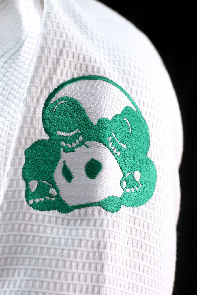 Shoulder patch of Inverted Gear White Gold Weave Panda Gi available at www.thejiujitsushop.com.  Comfortable light and durable Jiu Jitsu Gi from our panda nation friends at inverted gear.   Enjoy Free Shipping from The Jiu Jitsu Shop today!