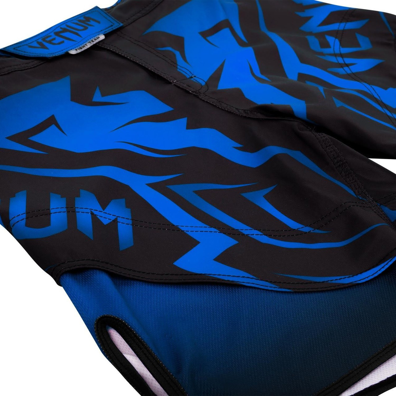 Flat picture of the Venum Shadow Hunter Fight Short in Blue and Black.  Available at www.thejiujitsushop.com.  Premium fight shorts shadow hunter  enjoy Free Shipping from The Jiu Jitsu Shop