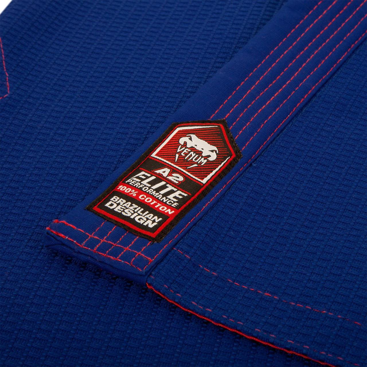 Venum Elite Jiu Jitsu Gi in Royal Blue and Red.  Now available at www.thejiujitsushop.com Front of gi in Blue  and Red   Enjoy free shipping from The Jiu Jitsu Shop.  Top quality brazilian jiu-jitsu gear for men women and kids.