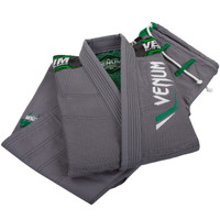 Venum Elite Jiu Jitsu Gi in Grey and Green.  Now available at www.thejiujitsushop.com Front of gi is black with great Silver and white accents   Enjoy free shipping from The Jiu Jitsu Shop.  Top quality brazilian jiu-jitsu gear for men women and kids.