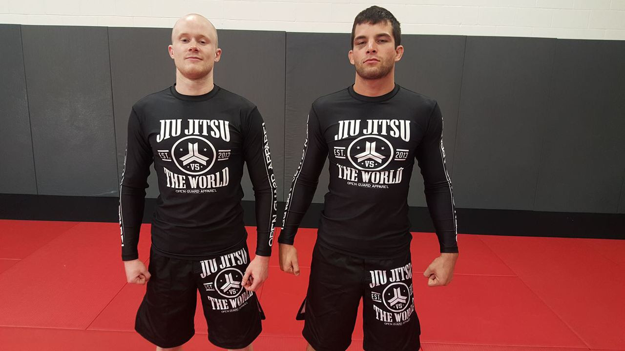 Jiu Jitsu Vs the world rashguard front view with Breno bittencourt and Robert Feutsel