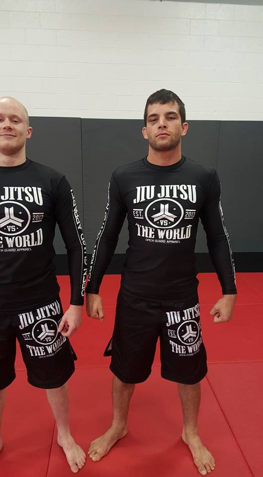 Full body picture of OGA Jiu Jitsu Vs The World Fight Shorts.  Great for BJJ and MMA.  Black and White Grappling Shorts from Open Guard Apparel.   Available with free Shipping from The Jiu Jitsu Shop.