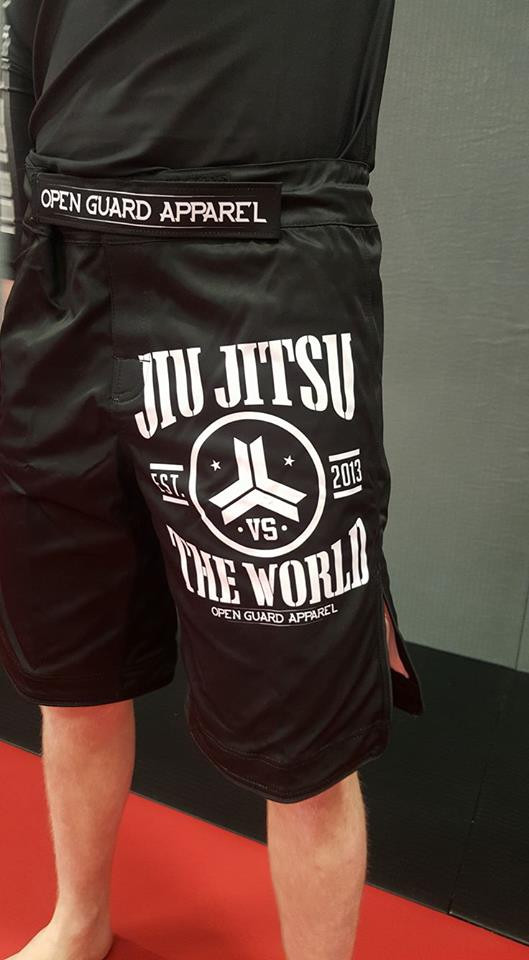 Front left pant leg of the OGA Jiu Jitsu Vs The World Fight Shorts.  Great for BJJ and MMA.  Black and White Grappling Shorts from Open Guard Apparel.   Available with free Shipping from The Jiu Jitsu Shop.