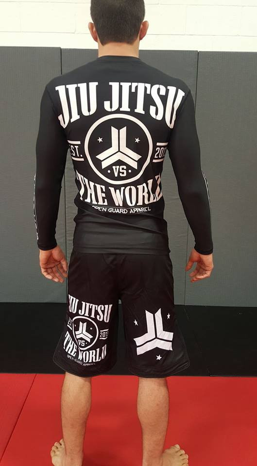 back side of the OGA Jiu Jitsu Vs The World Fight Shorts.  Great for BJJ and MMA.  Black and White Grappling Shorts from Open Guard Apparel.   Available with free Shipping from The Jiu Jitsu Shop.