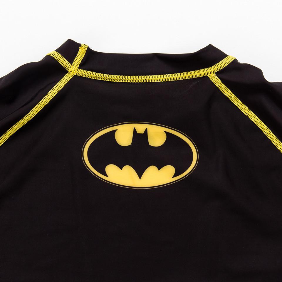 Fusion FG Batman Long sleeve Inverted logo rashguard.  Black and yellow.  Available at www.thejiujitsushop.com  Enjoy free shipping from The Jiu Jitsu Shop today.