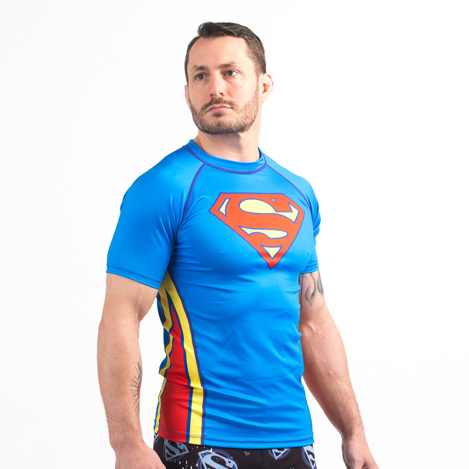 Side view of the Superman rashguard blue old logo
