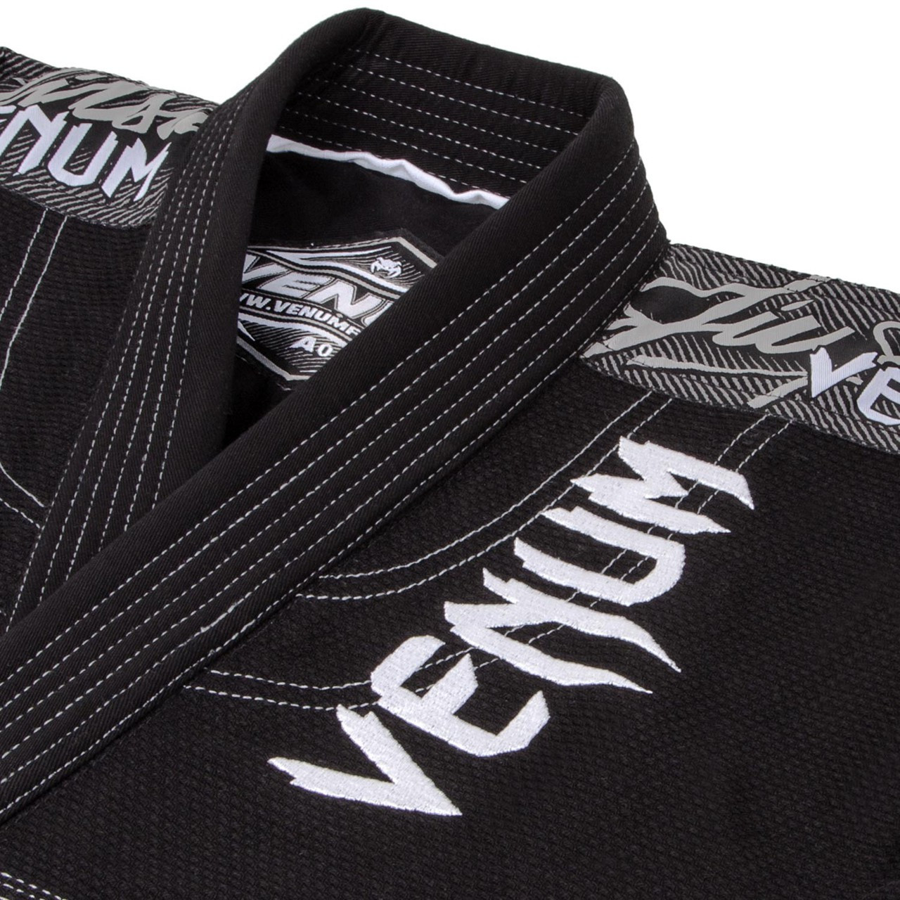 Zoom in to the jacket of the Venum challenger 3.0 BJJ Gi Black/Grey Available at www.thejiujitsushop.com  Enjoy Free Shipping from The Jiu Jitsu Shop today!