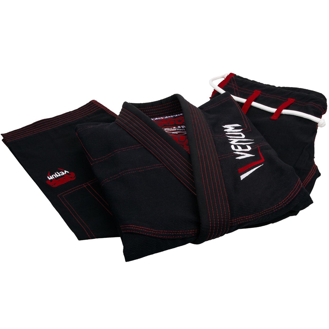 Folded gi and pants Venum Elite Light BJJ GI in Black is now available at www.thejiujitsushop.com  Enjoy Free Shipping from The Jiu Jitsu Shop today!