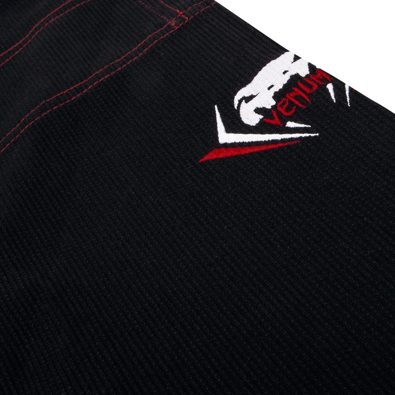 logo on the Venum Elite Light BJJ GI in Black is now available at www.thejiujitsushop.com  Enjoy Free Shipping from The Jiu Jitsu Shop today!