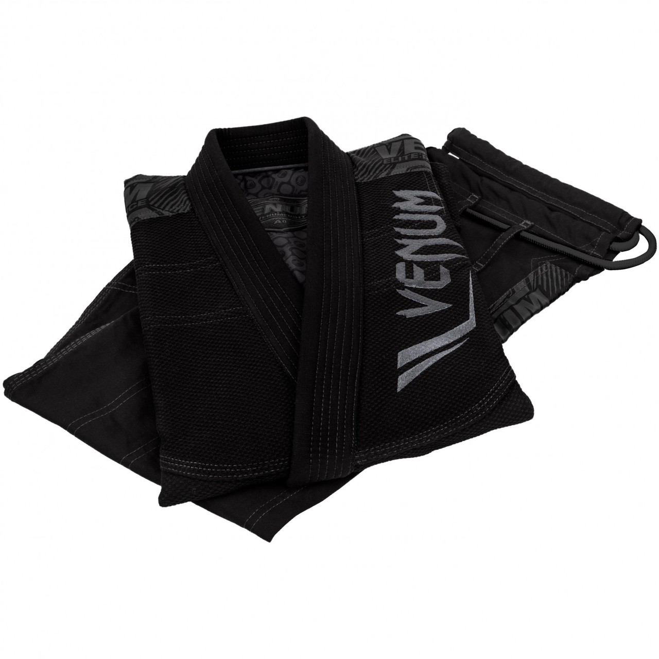 Folded gi Venum Elite BJJ GI in Black on black  is now available at www.thejiujitsushop.com  Enjoy Free Shipping from The Jiu Jitsu Shop today!