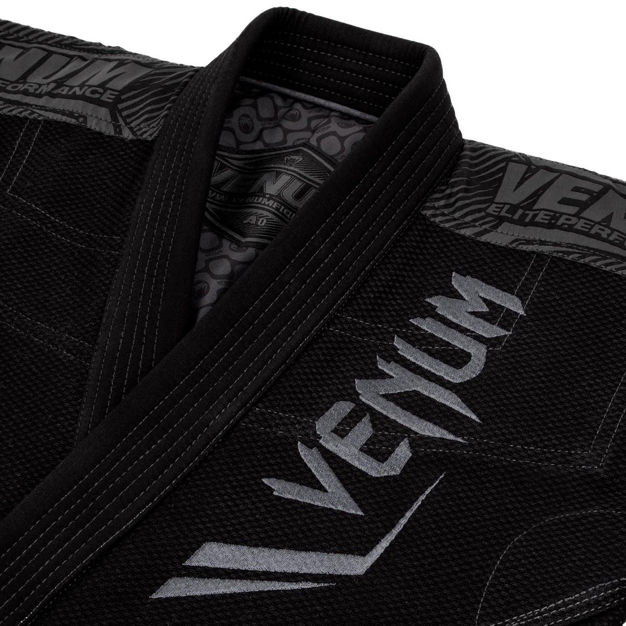 Zoomed into Venum logo Venum Elite BJJ GI in Black on black  is now available at www.thejiujitsushop.com  Enjoy Free Shipping from The Jiu Jitsu Shop today!