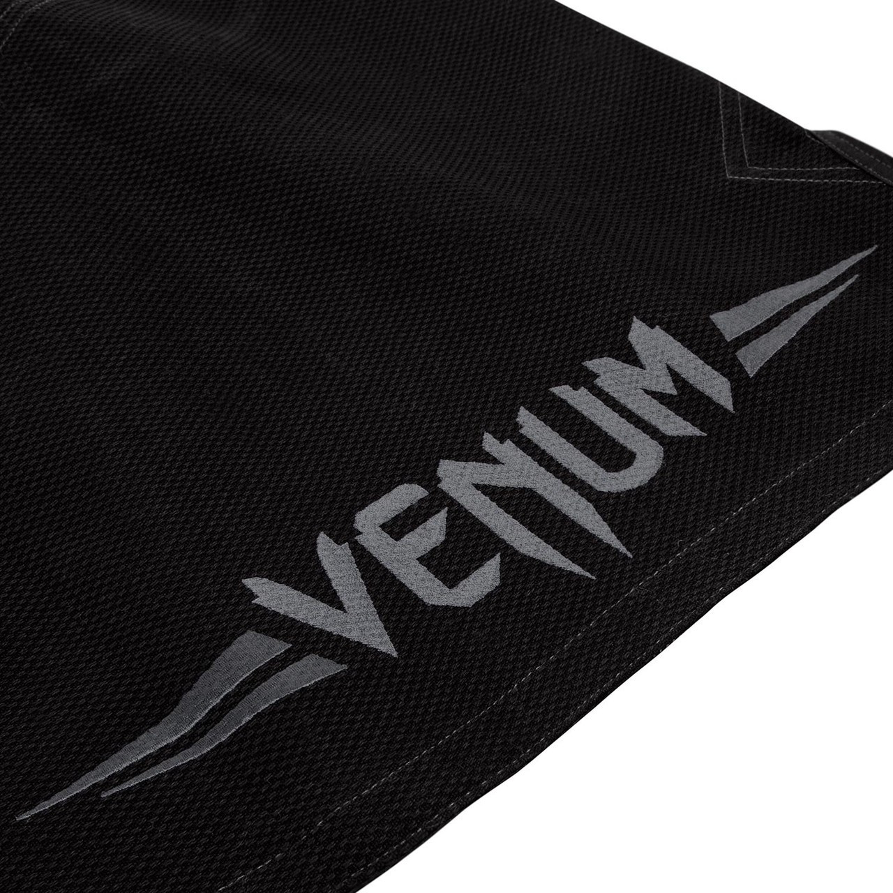 Botton back of the gi Venum Elite BJJ GI in Black on black  is now available at www.thejiujitsushop.com  Enjoy Free Shipping from The Jiu Jitsu Shop today!