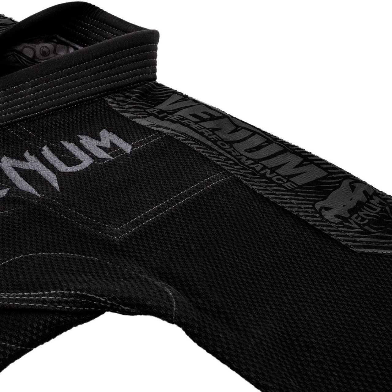 Top and arm of the Venum Elite BJJ GI in Black on black  is now available at www.thejiujitsushop.com  Enjoy Free Shipping from The Jiu Jitsu Shop today!