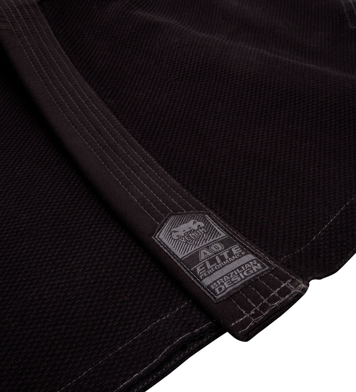 Lapel tip of the Venum Elite BJJ GI in Black on black  is now available at www.thejiujitsushop.com  Enjoy Free Shipping from The Jiu Jitsu Shop today!