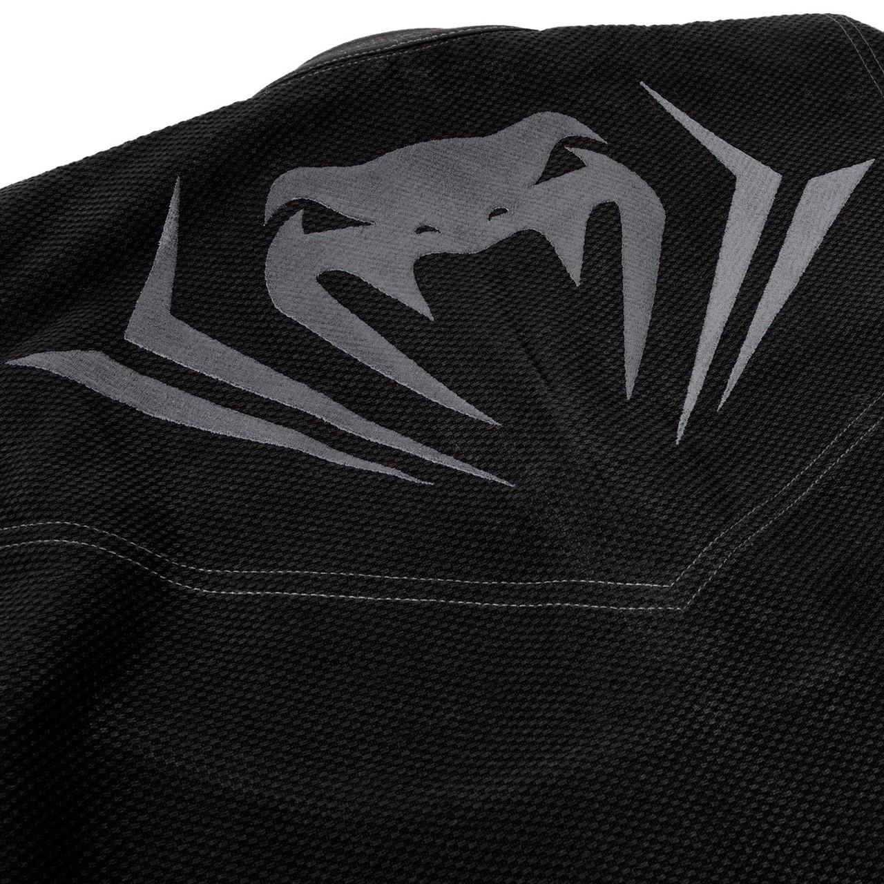 Upper snake logo Venum Elite BJJ GI in Black on black  is now available at www.thejiujitsushop.com  Enjoy Free Shipping from The Jiu Jitsu Shop today!