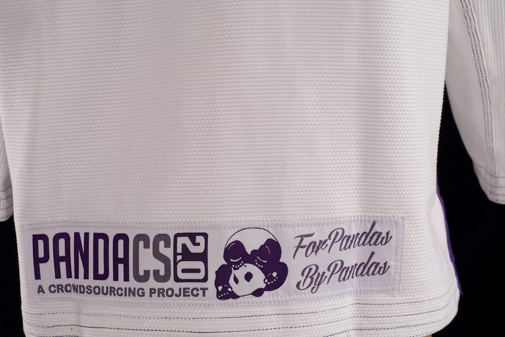 Back view of the Inverted Gear Panda CS 2.0 .  The revamped crowdsourced gi.  White and purple from The Jiu Jitsu Shop.  Enjoy free shipping today at www.thejiujitsushop.com