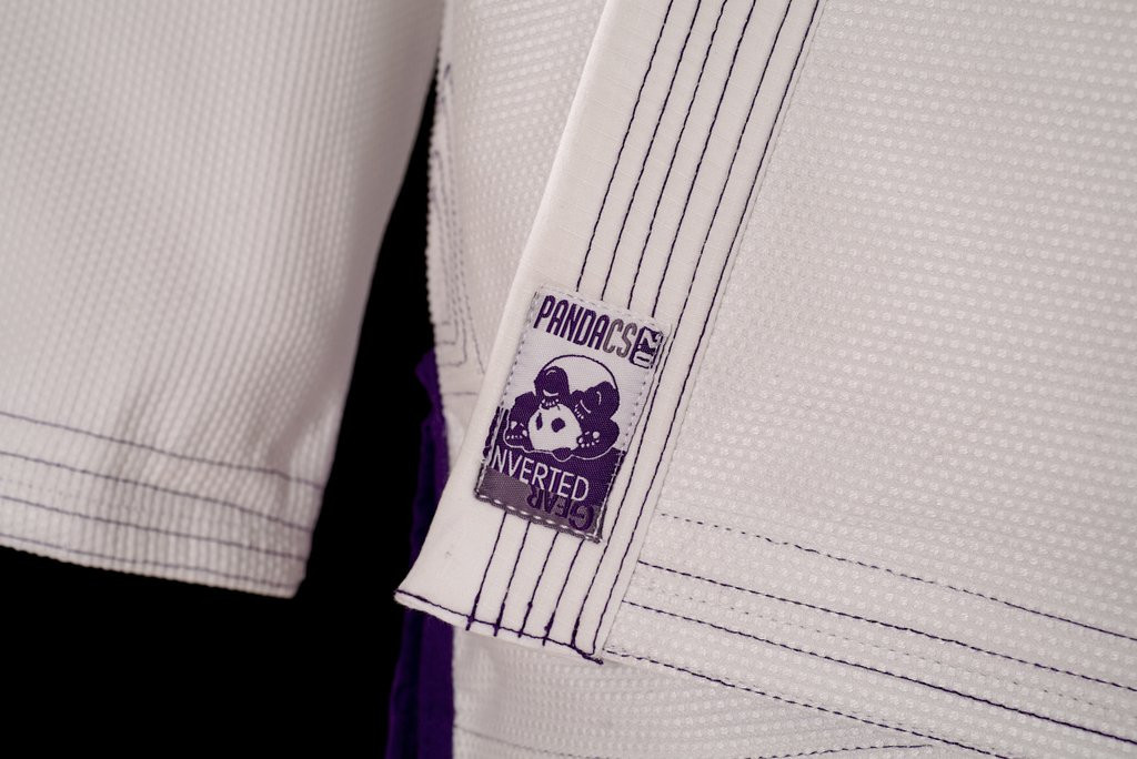 Lapel patch of the Inverted Gear Panda CS 2.0 .  The revamped crowdsourced gi.  White and purple from The Jiu Jitsu Shop.  Enjoy free shipping today at www.thejiujitsushop.com