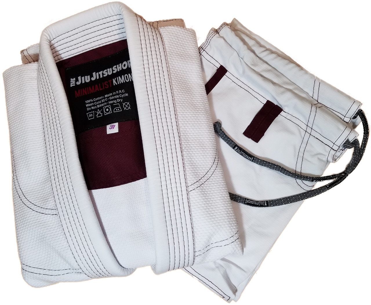 The Jiu Jitsu Shop Minimalist White with Burgandy accents.  Specifically cut for women.  Available at www.thejiujitsushop.com  Enjoy Free Shipping today!