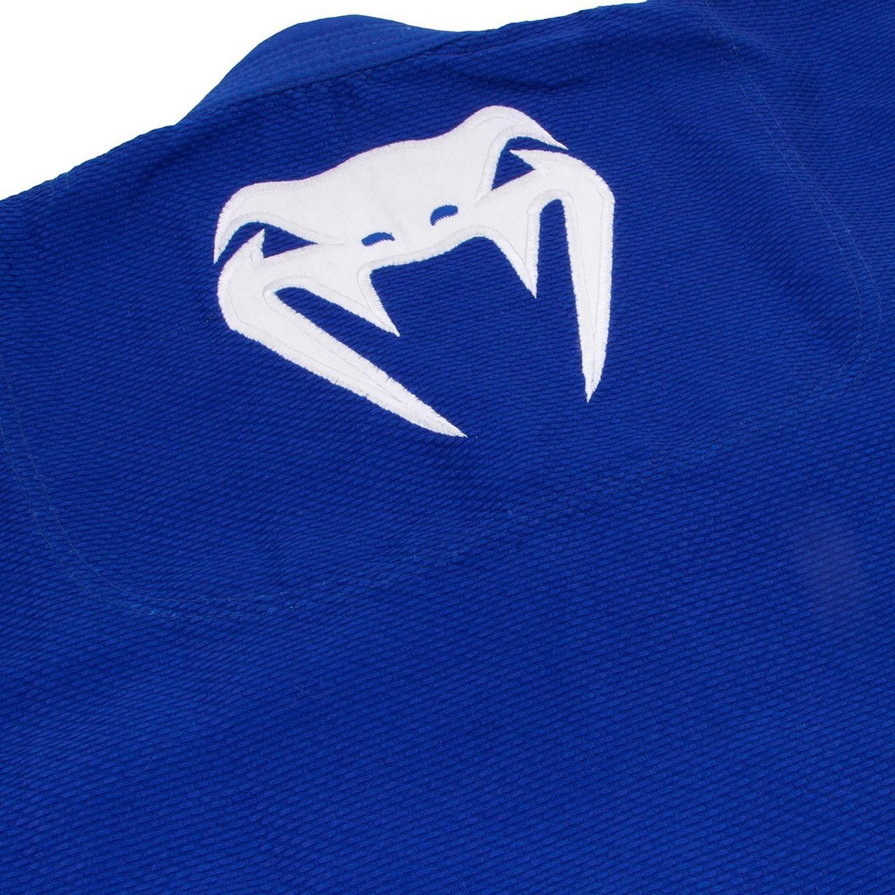 Back of the gi logo. Venum Contender 2.0 Blue BJJ GI available at www.thejiujitsushop.com  Enjoy Free Shipping from The Jiu Jitsu Shop today!