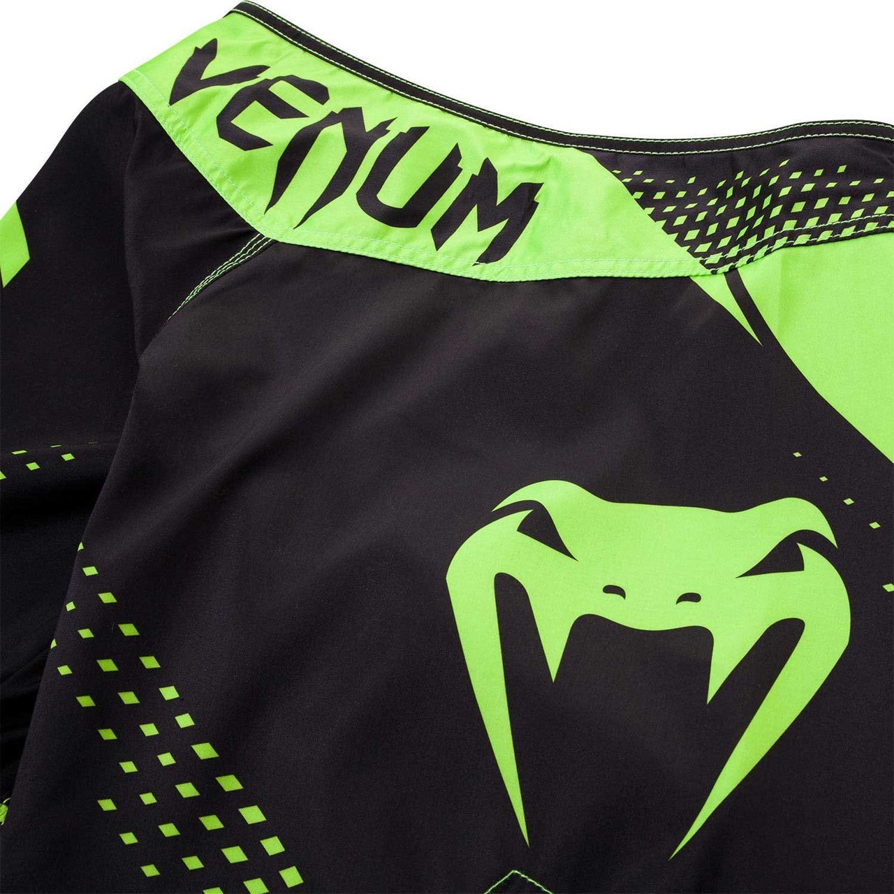 back zoom into the Venum Hurricane Fight Shorts now available at www.thejiujitsushop.com Bring black and green shorts to take on the world.   Enjoy Free Shipping from The Jiu Jitsu Shop today!