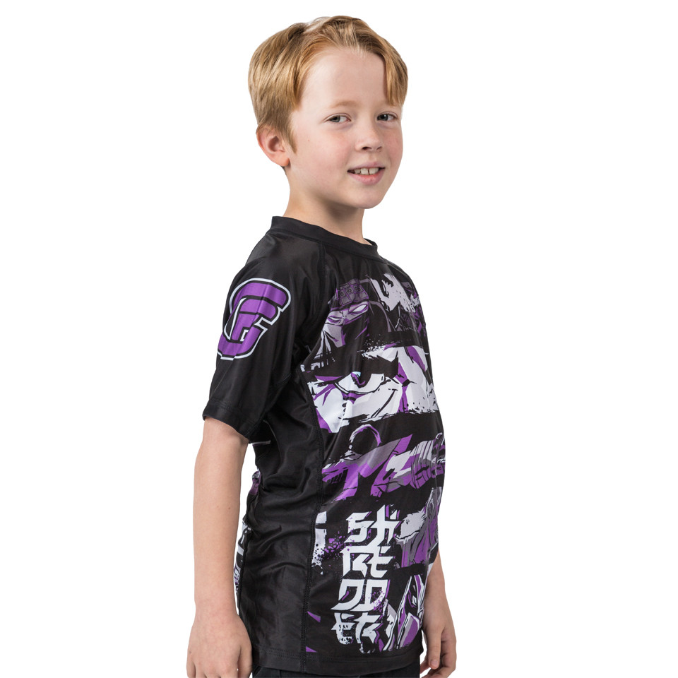 Side pose of the Fusion FG Teenage Mutant Ninja Turtles Shredder Rashguard for Kids.  Available at www.thejiujitsushop.com  Enjoy Free Shipping from The Jiu Jitsu shop today!