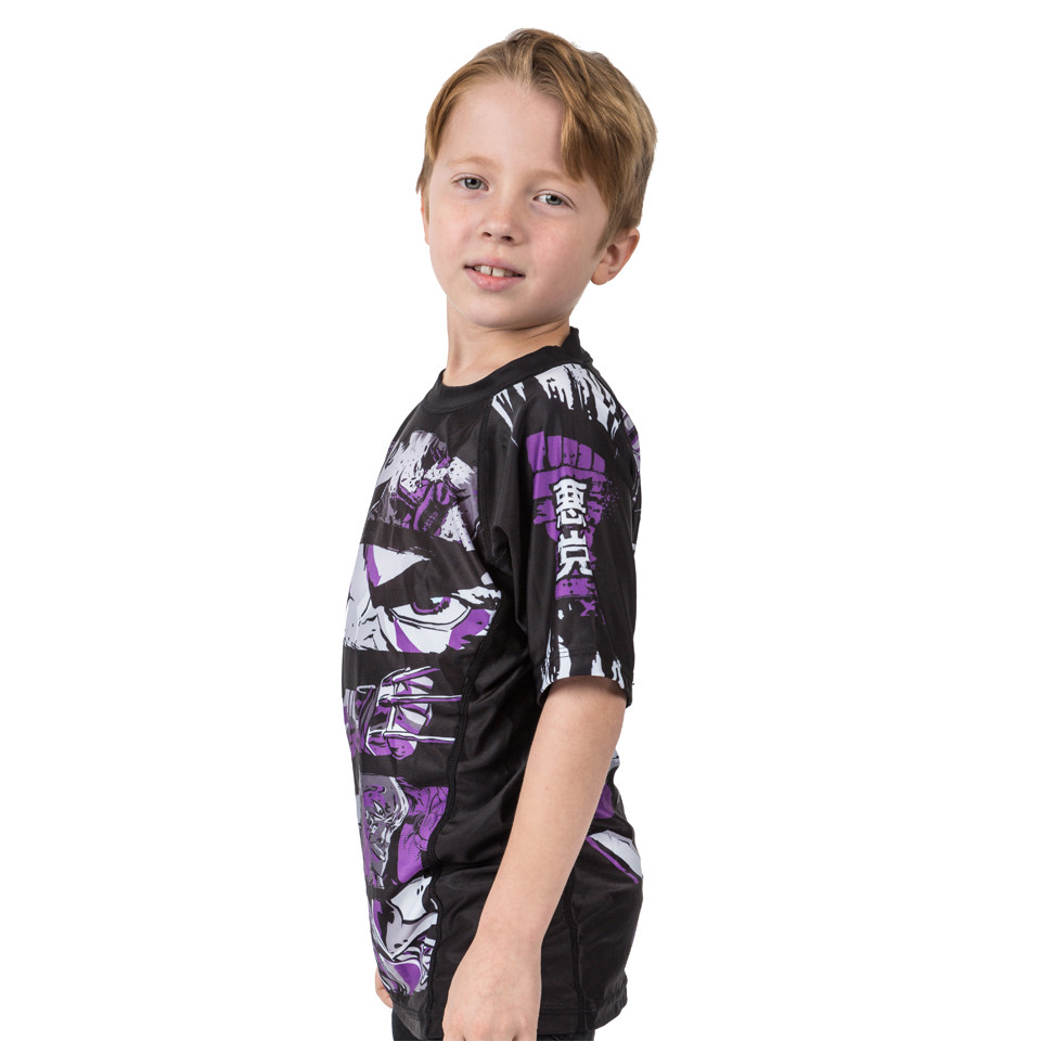 Left side pose with model for the Fusion FG Teenage Mutant Ninja Turtles Shredder Rashguard for Kids.  Available at www.thejiujitsushop.com  Enjoy Free Shipping from The Jiu Jitsu shop today!