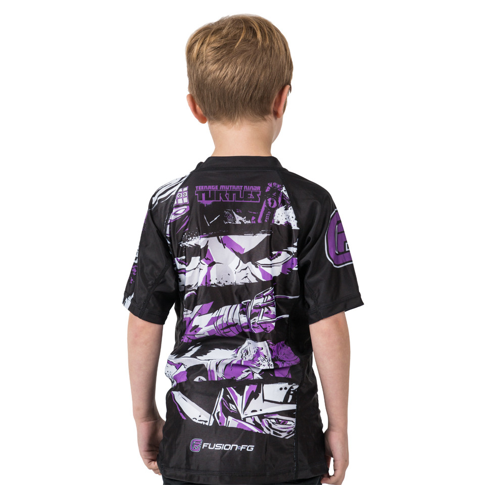 Back kids view of the Fusion FG Teenage Mutant Ninja Turtles Shredder Rashguard for Kids.  Available at www.thejiujitsushop.com  Enjoy Free Shipping from The Jiu Jitsu shop today!