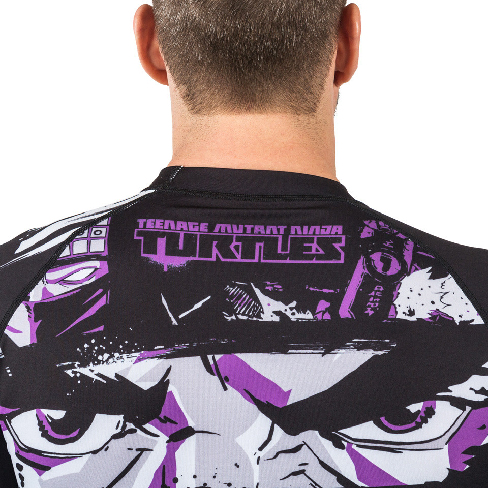 Top back of the fusion Teenage Mutant Ninja Turtles Short sleeve rashguard.  Available at www.thejiujitsushop.com  Enjoy Free Shipping from The Jiu Jitsu Shop today!