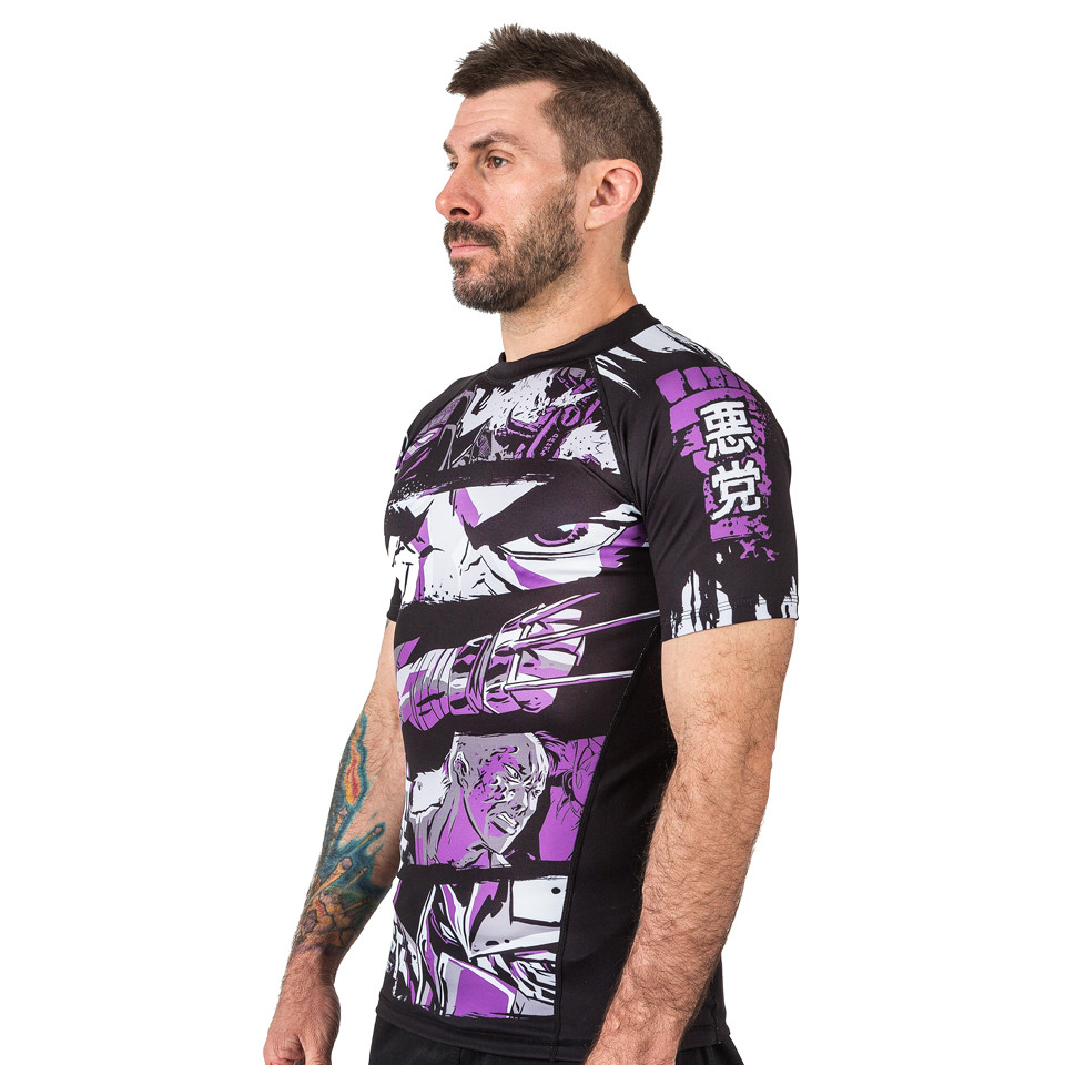 Model looking left of the fusion Teenage Mutant Ninja Turtles Short sleeve rashguard.  Available at www.thejiujitsushop.com  Enjoy Free Shipping from The Jiu Jitsu Shop today!