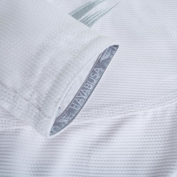 Zoom into the sleeve of the Hayabusa Stealth Jiu Jitsu Gi in White available at www.thejiujitsushop.com  Enjoy Free Shipping from The Jiu Jitsu Shop.