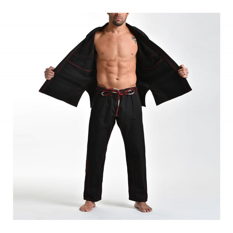 Model of the Grips athletics Cali 99 Gi black gi.  Available at www.thejiujitsushop.com  Enjoy free shipping from The Jiu Jitsu Shop today!
