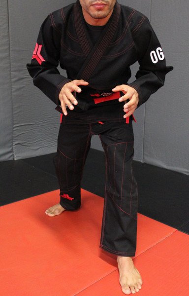 Open Guard Apparel Champion Gi, featured in black with red contrast! Available at www.openguardapparel.com.  Enjoy premium BJJ gear for the family.