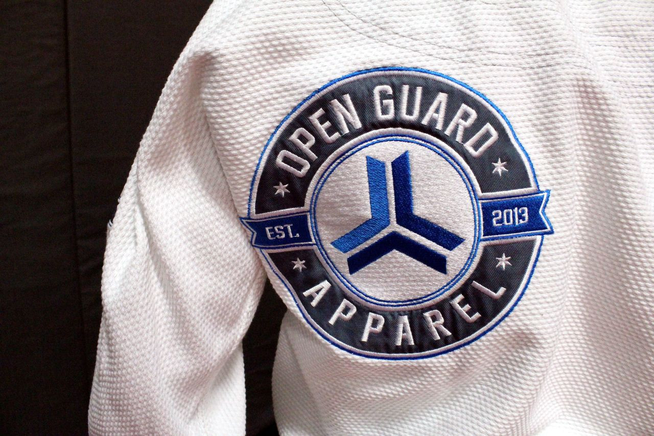 Open Guard Apparel White Blizzard Gi now available in www.thejiujitsushop.com  Teal accents across the gi ready for the mats.   Enjoy Free Shipping from The Jiu Jitsu Shop today!