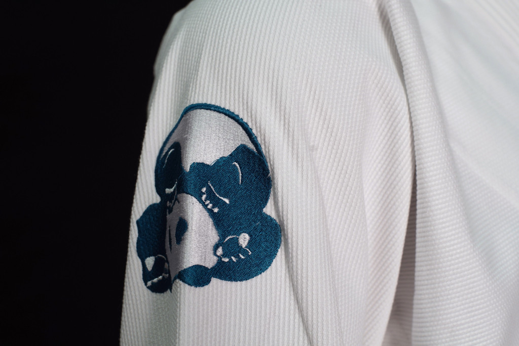Inverted Gear White Light Pearl Weave Gi - The Jiu Jitsu Shop @ www.thejiujitsushop.com   Zoom in on embroidery patch side