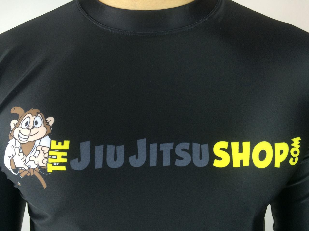 "The Jiu Jitsu Shop's ""Essentials"" Long-Sleeve Rashguard, featuring our buddy Rocky the Monkey. Exclusively at www.thejiujitsushop.com. Free domestic shipping storewide."