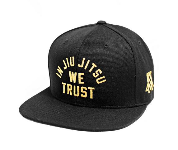 Newaza Apparel In Jiu Jitsu We Trust Gold on Black Hat.  Now available at www.thejiujitsushop.com.  Enjoy complimentary shipping from The Jiu Jitsu Shop on this one of a kind hat.    Great stitching and workmanship.